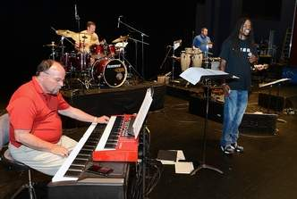 CHIP ELLIS | Sunday Gazette Mail photos - During a rehearsal at the Clay Center, Duane Flesher (from left) plays piano, Brandon Willard plays drums, Levi Billiter plays percussion instruments and Landau Eugene Murphy Jr. sings.