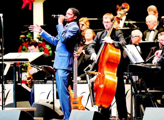 Sholten Singer/The Herald-Dispatch Landau Eugene Murphy Jr. and his 2014 Murphy and Motown Christmas Tour join with the Huntington Symphony Orchestra for a performance on Saturday, Dec. 20, 2014, at the Keith-Albee Theatre in downtown Huntington, W.Va.